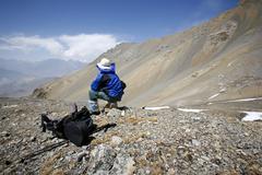 man admiring view in the himalayas, annapurna, nepal - stock photo