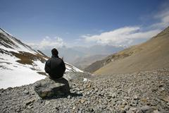 Man admiring view in the himalayas, annapurna, nepal Stock Photos