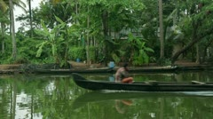 Local people travelling in boat in Kerala Backwaters Stock Footage
