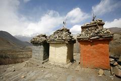tibetan memorial tombs, annapurna, nepal - stock photo