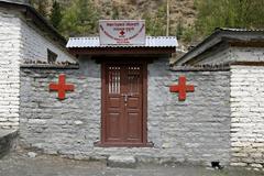 Small red cross dispensary on the annapurna circuit, nepal Stock Photos