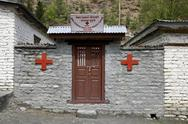 Stock Photo of small red cross dispensary on the annapurna circuit, nepal