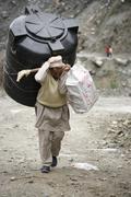 Man carrying water reservoir, annapurna, nepal Stock Photos