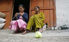 local women knitting in village, annapurna, nepal - stock photo