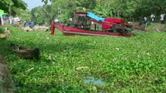 ALLEPPEY, KERALA, INDIA - MARCH 2013: Floating digger at work on canal in Kerala Stock Footage