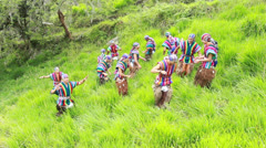 Twelve dancers performing a Ecuadorian dance, wearing traditional costumes, - stock footage