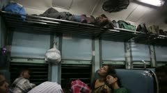 KANYAKUMARI, TAMIL NADU, INDIA - MARCH 2013: People travelling in train carriage Stock Footage
