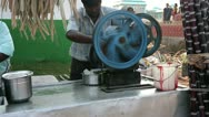 Stock Video Footage of KANYAKUMARI, TAMIL NADU, INDIA - MARCH 2013: Domestic melassa production on