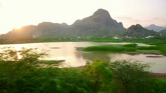 Scenic landscapes passing behind train window Stock Footage