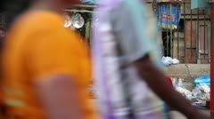 MADURAI, TAMIL NADU, INDIA - MARCH 2013: Everyday scene with woman selling goods Stock Footage