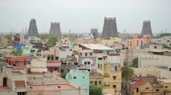 Cityscape with Hindu temples stretching behind rooftops Stock Footage