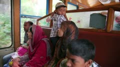 OOTY, INDIA - MARCH 2013: local people travelling on historical steam-powered Stock Footage