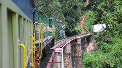 Train cautiously crossing railway bridge - stock footage