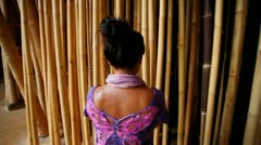 Woman in bamboo forest Stock Footage