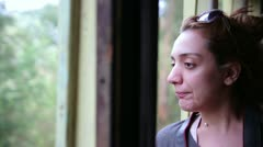 Female tourist peeking out of historical steam-powered train window Stock Footage