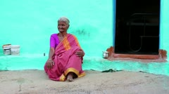 HAMPI, KARNATAKA, INDIA - APRIL 2013: Portrait of old woman in sari sitting in Stock Footage