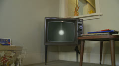 1960's  The Sun newspaper commercial on old tv Stock Footage