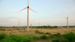 Train passing by working wind turbines Stock Footage