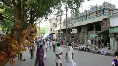 MADURAI, TAMIL NADU, INDIA - MARCH 2013: Busy street scene with pedestrians Stock Footage