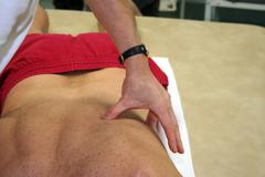 physiotherapist handling patient - stock photo