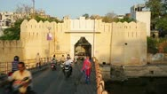 Stock Video Footage of UDAIPUR, RAJASTHAN, INDIA - APRIL, 2013: Everyday city life scene with traffic