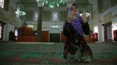 Muslim girl saying her everyday salat prayer, close up - stock footage
