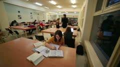 Girl studying in library, fast motion - stock footage