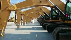 Caterpillars, Yellow heavy construction work vehicles, parking Stock Footage