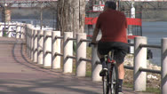 Stock Video Footage of Senior Cycling On Bike Trail, Arkansas