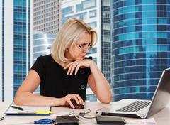 mature business woman working in the office - stock photo