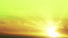 Sunburst green and orange sunset time lapse - stock footage