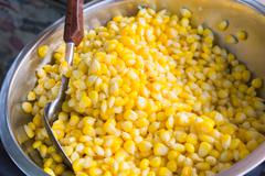 sweet corn with butter in a bowl. - stock photo