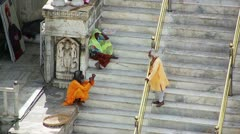 UDAIPUR, RAJASTHAN, INDIA - APRIL, 2013: Everyday scene with people sitting on Stock Footage