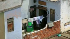 Clothes drying in the sun at poor ghettos - stock footage