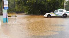 Police car road blockade during flood. Stock Footage