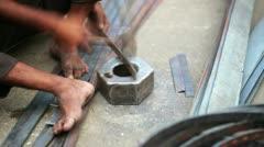 Local craftsman working on piece of metal, Jaipur, India Stock Footage
