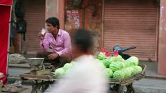 JAIPUR, RAJASTHAN, INDIA - APRIL, 2013: Man selling watermelons in the street Stock Footage