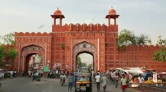 JAIPUR, RAJASTHAN, INDIA - APRIL, 2013: Everyday traffic scene and historic Stock Footage
