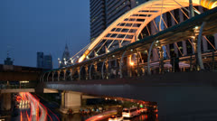 Twilight of buildings and public sky walk, Bangkok, Thailand Stock Footage