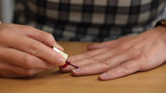 Woman apply red nail polish /episode 4/ Stock Footage
