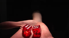 Hand grasping red dice Stock Footage