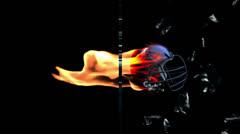 Football-Helmet on fire breaking glass, side view Stock Footage