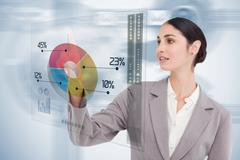 Businesswoman using colorful futuristic interface - stock photo