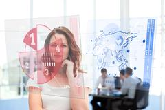 Smiling businesswoman looking at red pie chart interface Stock Photos