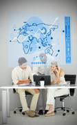 Three business people using blue map diagram interface Stock Photos