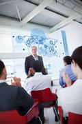 Business people clapping stakeholder standing in front of map diagram interface - stock photo