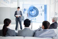 Business people listening and looking at blue diagram interface Stock Photos