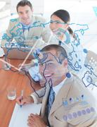 Overview of cheerful colleagues looking at blue map interface - stock photo