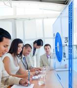 Group of colleagues using blue pie chart interface - stock photo