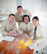 Overview of happy colleagues using yellow pie chart interface - stock photo